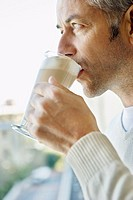 Man Drinking Cafe Latte