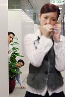 Men Eavesdropping on Co-Worker