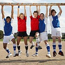 Soccer Players Hanging from Goal