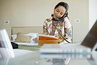 Businesswoman Working in Hotel Room