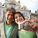 Couple Using Digital Camera on Vacation