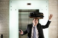 Businessman Balancing Briefcases on Head
