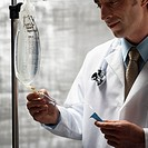 Doctor Prepping Intravenous Equipment