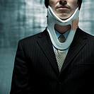 Businessman Wearing Neck Brace