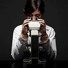 Woman Looking in Microscope