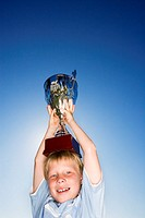 Boy Holding Trophy on Head