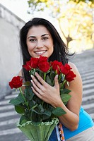 Smiling Woman with Red Roses