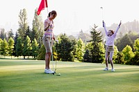Mother and Daughter on Putting Green