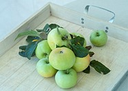 Apples with leaves, on tray