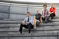 Businesspeople Sitting on Steps