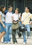 Teens standing outdoors, talking
