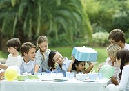 Family having outdoor birthday party