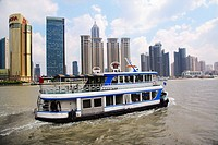 China, Shanghai, Hunagpu River Ferry against the backdrop of Pudong high-rise