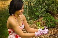 African American woman gardening