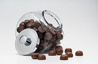 Chocolate candy in glass container withmetal lid off