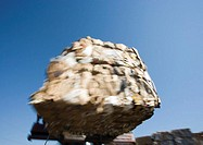 Forklift transporting bales of paper