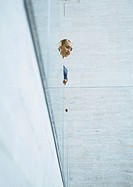 Woman looking over edge of balcony (thumbnail)