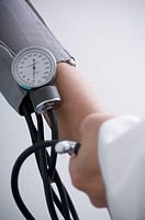 Woman having blood pressure taken