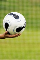 Close-up of a person´s hand holding a soccer ball