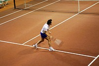 High angle view of a mid adult man playing tennis