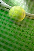 Close-up of a tennis ball and two tennis rackets