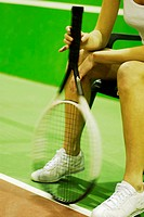 Close-up of a woman holding a tennis racket