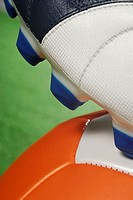 Close-up of a soccer shoe and a soccer ball