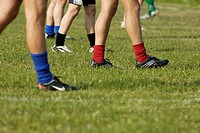 Low section view of a group of soccer players walking on a soccer field (thumbnail)