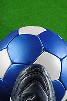 High angle view of a soccer shoe and a soccer ball