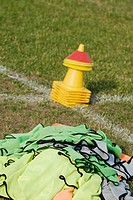 Close-up of traffic cones in a soccer field