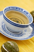 Close-up of a cup of herbal tea on a saucer