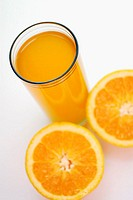 High angle view of a glass of juice with lemon slices (thumbnail)