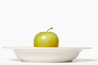Close-up of an apple in a bowl