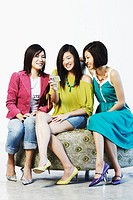 Three young women using a digital camera