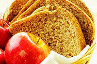 Close-up of apples and brown bread in a basket