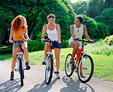 Three young women cycling, Bermuda