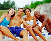 Portrait of two young couples sitting on lounge chairs and smiling, Bermuda (thumbnail)