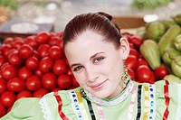 Portrait of a young woman at a market stall