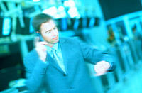 Businessman using cell phone and looking at watch