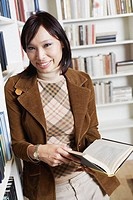 Portrait of a businesswoman holding a book smiling