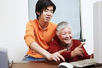 Close-up of a grandmother and her grandson using a computer