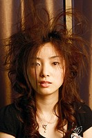 Portrait of a young woman with tousled hair