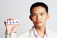 Portrait of a businessman holding marble cubes