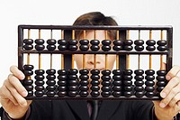 Close-up of a businessman holding an abacus