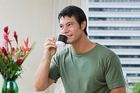 Mid adult man drinking a cup of tea
