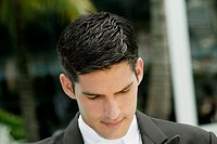 Close-up of a groom looking down