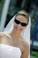 Close-up of a bride wearing sunglasses