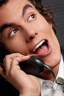 Close-up of a businessman talking on the telephone