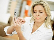 Close-up of a mid adult woman operating a mobile phone