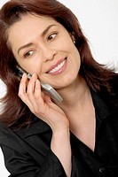 Close-up of a mid adult woman using a mobile phone